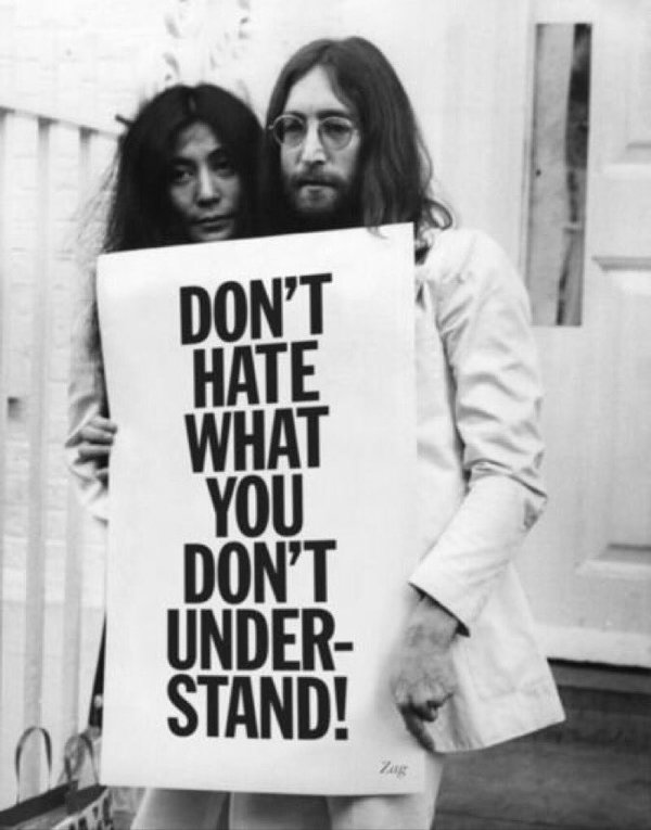 John Lennon And Yoko Ono Holding A Sign HoaxEye